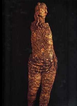 Statue en bois, d'un homme sauvage